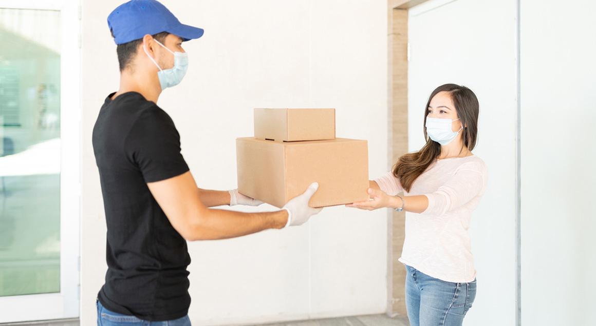 Stock delivering packages wearing masks
