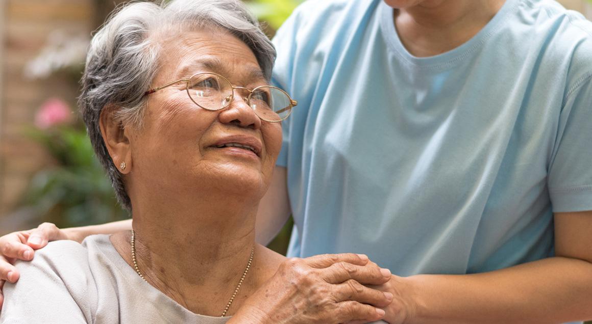 Stock elderly woman with caretaker