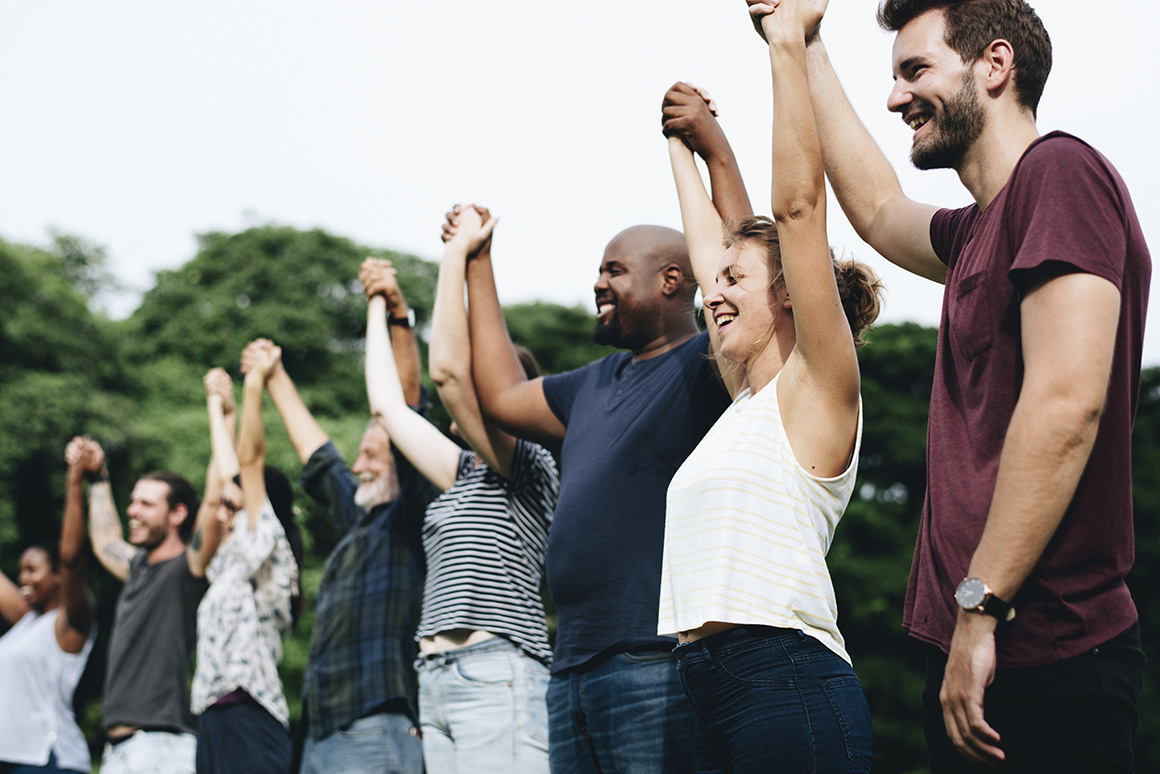 Stock group holding hands raising arms