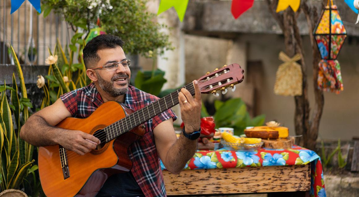 Stock man playing guitar