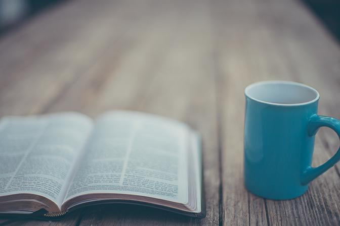 Stock open bible and coffee mug