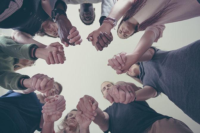 Stock people holding hands in a circle