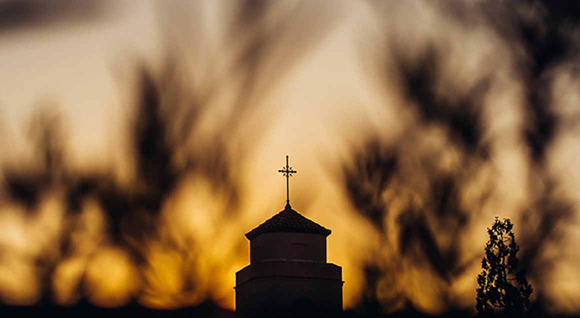 Stock sunrise over church 1160x636