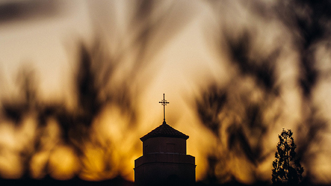 Stock sunrise over church steeple