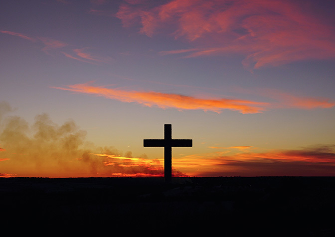 Stock sunrise over cross