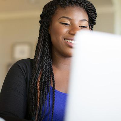 Woman looking at computer screen 400x400