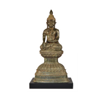 A Bronze seated Buddha on a double Lotus base
