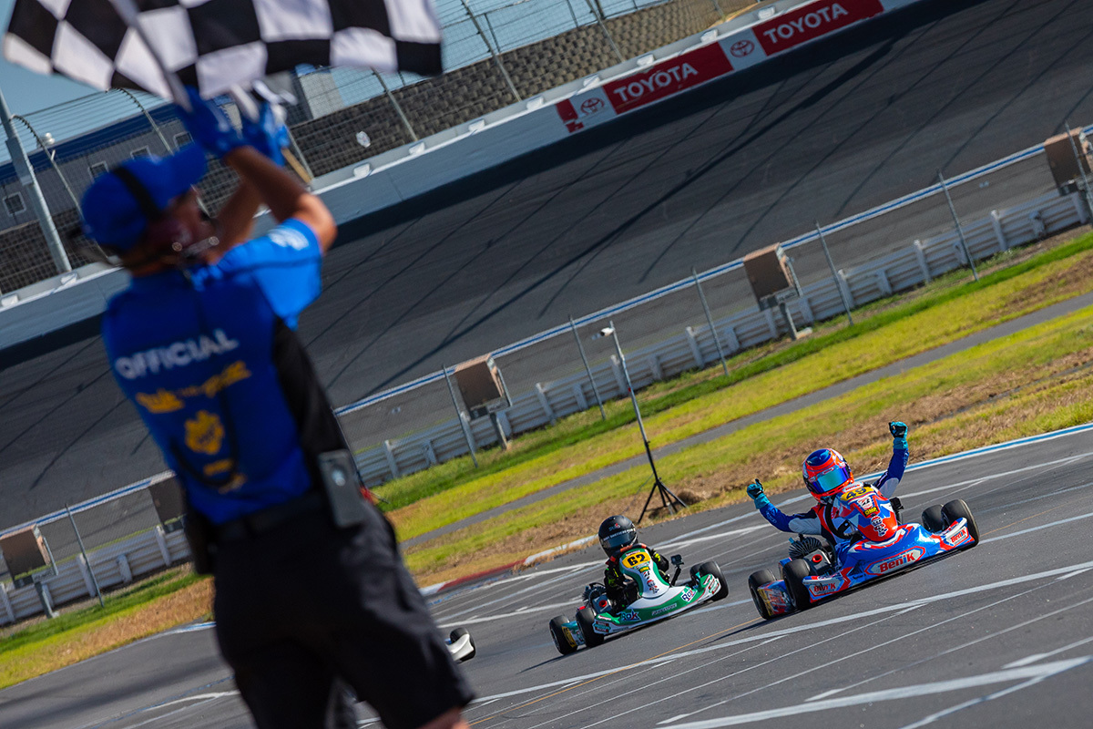 Asher Ochstein celebrates his Micro ROK win at the Charlotte Motor Speedway