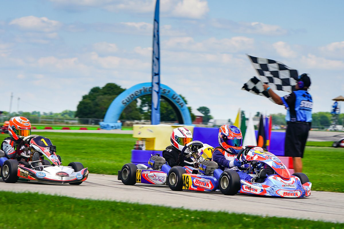 Asher Ochstein drives his Benik Kart past the checkered flags at the 2020 SKUSA Summernationals