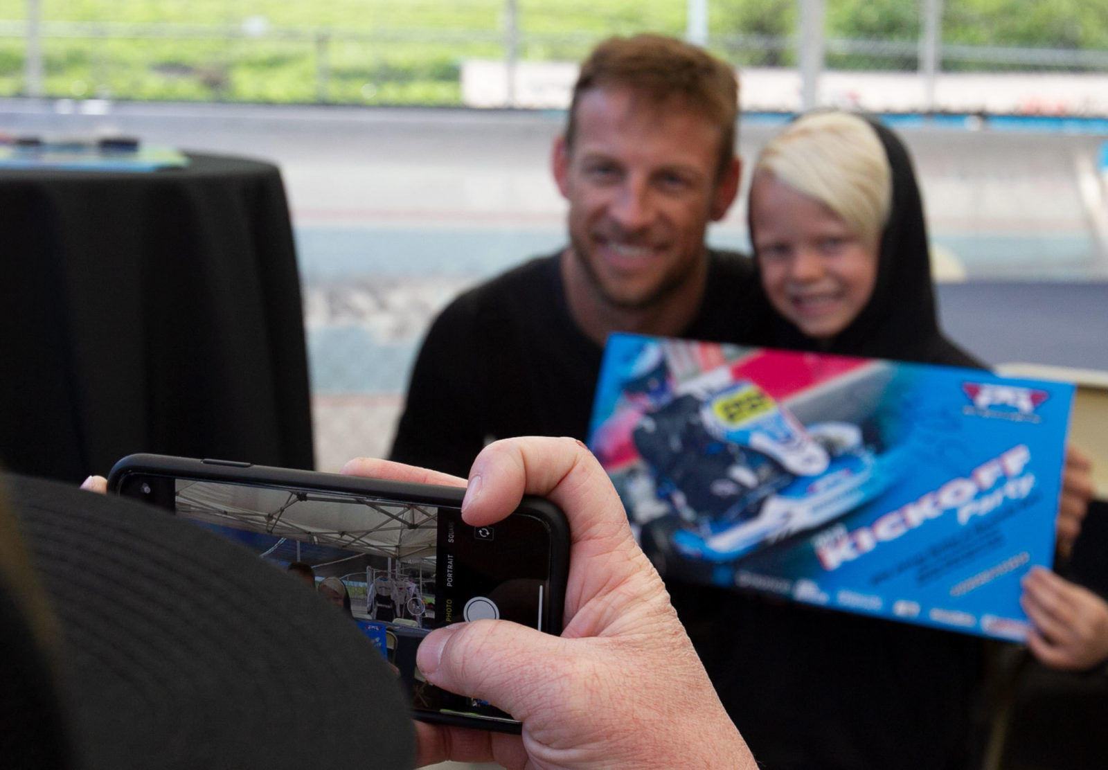 Jenson poses for a photo with a young fan at Adams Motorsports Park in Riverside, California.