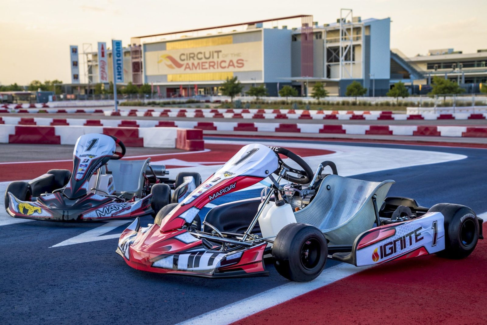 Margay Ignite karts sit on the asphalt of the Circuit of the Americas karting facility