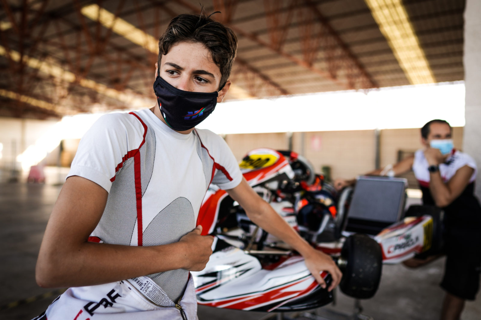 A young driver wears a medical protective mask at the first round of the 2020 FIA Karting European Championship