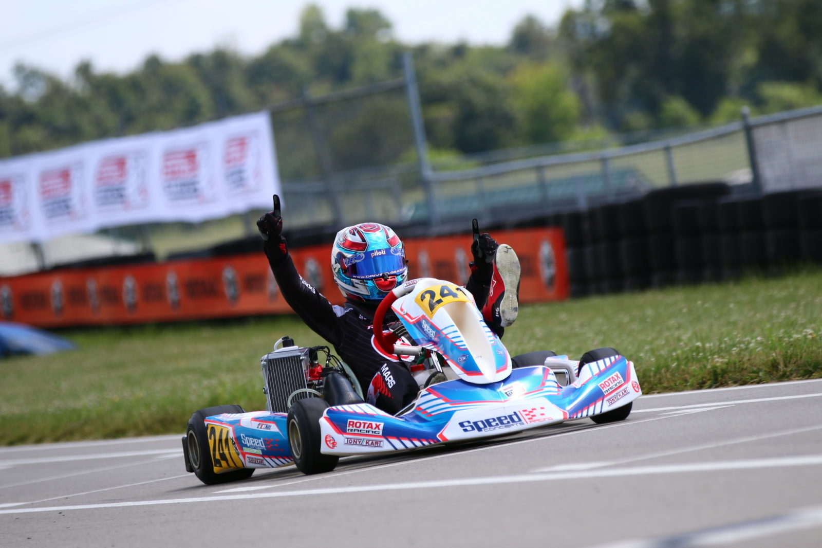 Luca Mars celebrates across the finish line of the 2019 Stars and Stripes Open in Wampum, PA