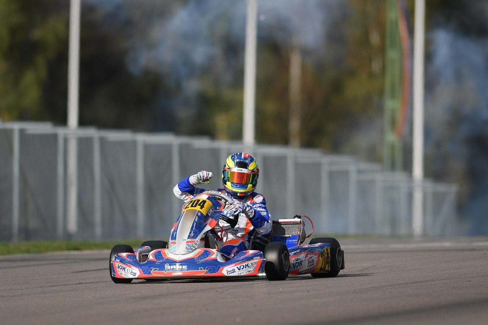 Victor Bernier pumps his arm as he cross the finish line at the 2018 FIA Karting World Junior Championship in Kristianstad, Sweden