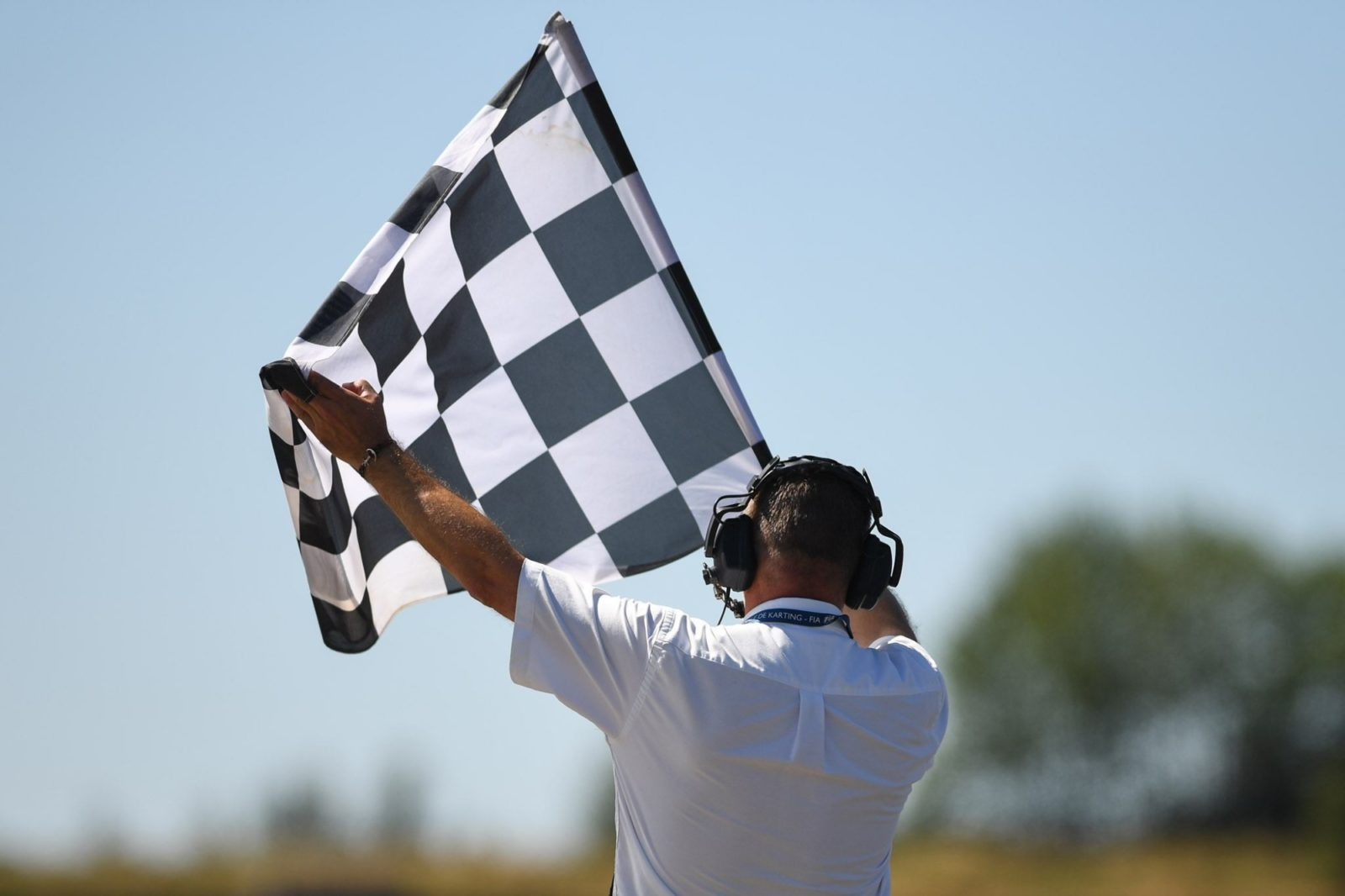 Flag marshall waves the checkered flag in Essay, France, European Championship