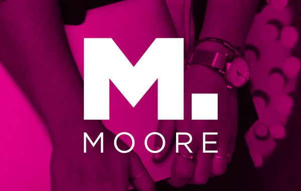 Moore white logo with the magenta pink background.
