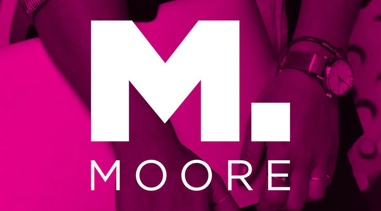 Moore logo with hands holding a computer in the background