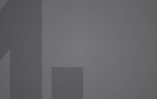 Grey Moore logo on grey background.