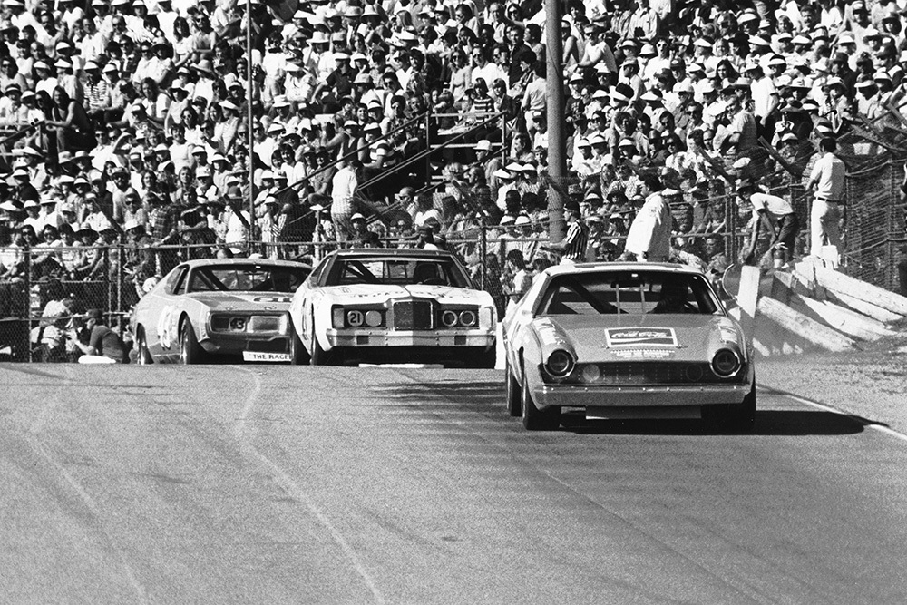 Bobby Allison leads David Pearson, Richard Petty and the rest of the field at Riverside International Raceway in the 1975 Winston Western 50