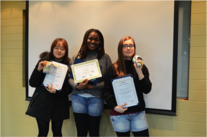 Two NSLI-Y students pose with their Korean mentor, along with their certificates and prizes from Better World.
