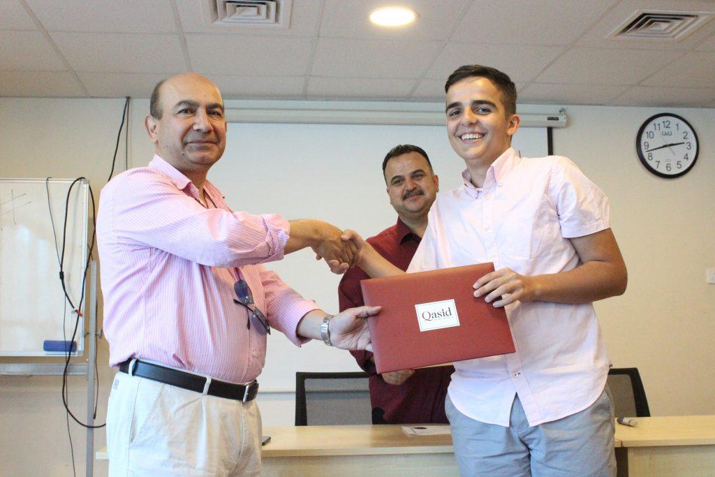 Deni pictured receiving a certificate