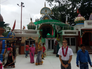 Jordan pictured in front of a temple in India