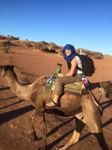 Madeleine pictured riding a camel in the desert