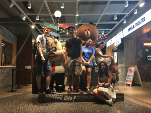 Justin pictured with his friends in front of Line Friends' famous teddy bear.