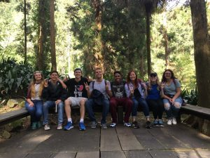 Pablo posing in a forest with his friends from the NSLI-YAcademic Year program.