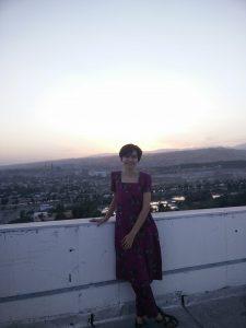 Mira posing in front of a Tajiki sunset.