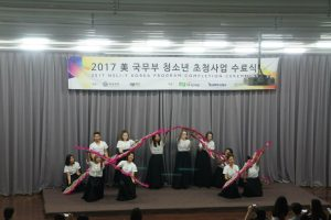 Carlie and her fan dancing team performing at the closing ceremony.
