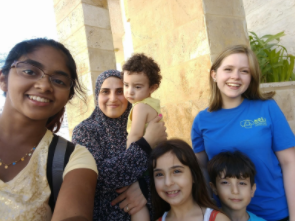 Meenu (left) takes a selfie with her host family and fellow NSLI-Y participant.