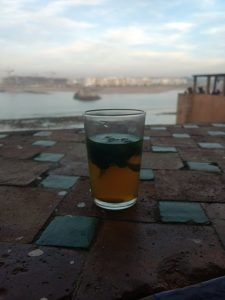A photo of tea placed in front of a beautiful sky.