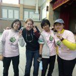 Greta poses with a Taiwanese robotics team.