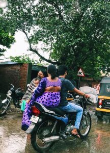Photo of locals on a motorcycle