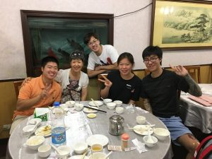 William pictured at a dinner table with his host family