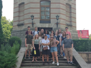 The students pose for a group shot in front of the WaterTower while on their city tour of Chisinau.