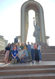 Participants and local coordinator pose in front of a statue of Ismoili Somoni in Dushanbe.