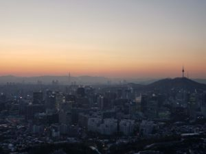 A winter sunrise in Seoul with a view of the city