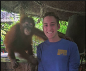Sam with an orangutan