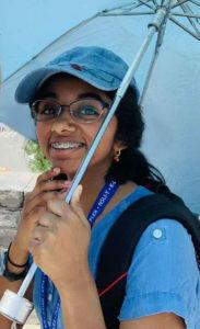 Aparna holding her umbrella