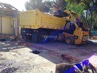 Servicio de retiro de escombros con mini cargador
