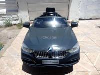 Auto Gris BMW con Control Remoto