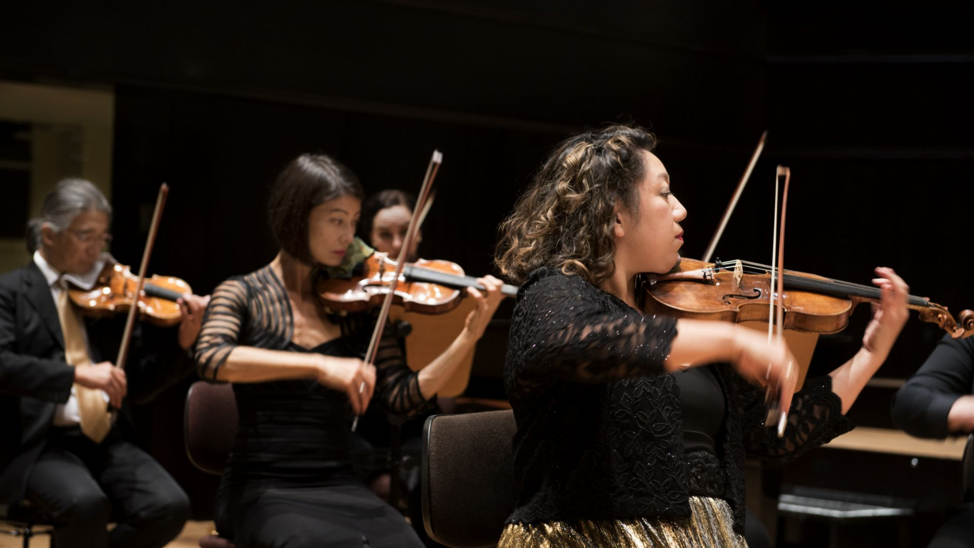 Violin section credit Neda Navaee