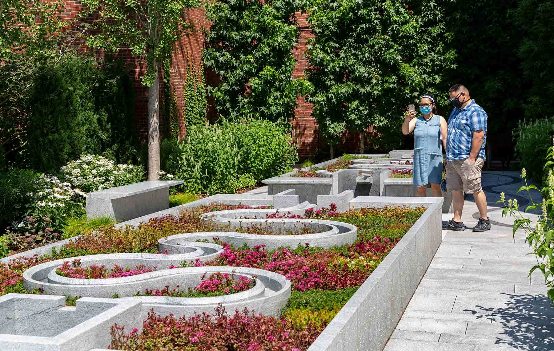 Visitors enjoy the warm weather in the new garden — the first time the space has seen a summer in New England since its opening.