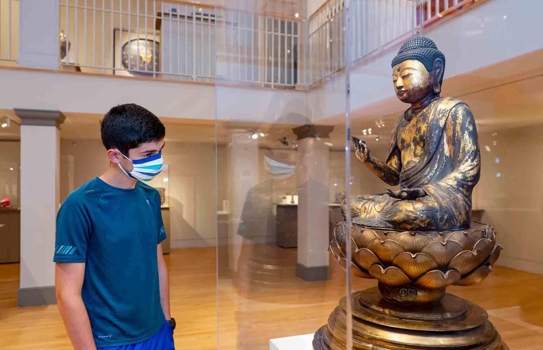 Julien Marrero, 14, enjoys wandering the museum by himself.