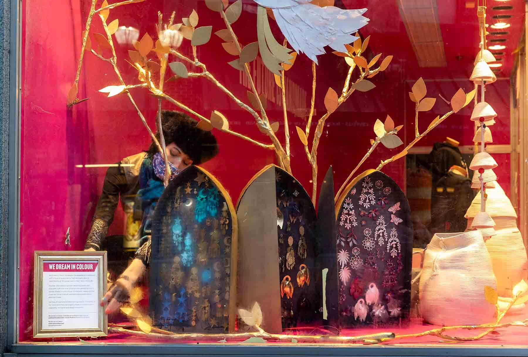 The PEM shop windows with bright pink walls and ornaments on display