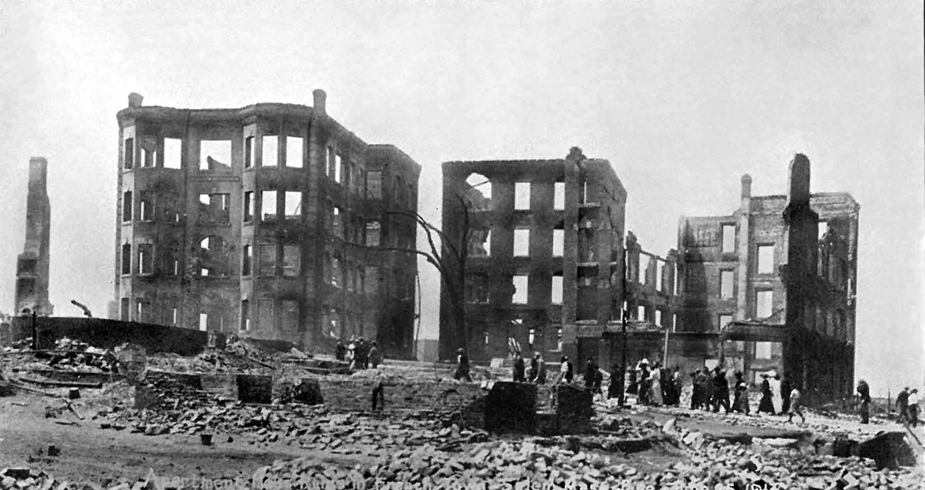 Photographer in Salem, Massachusetts, French District, destroyed apartments in the aftermath of the Great Salem Fire of 1914, June 26, 1914, Phillips Library, Salem Streets Collection, Negative #32851.