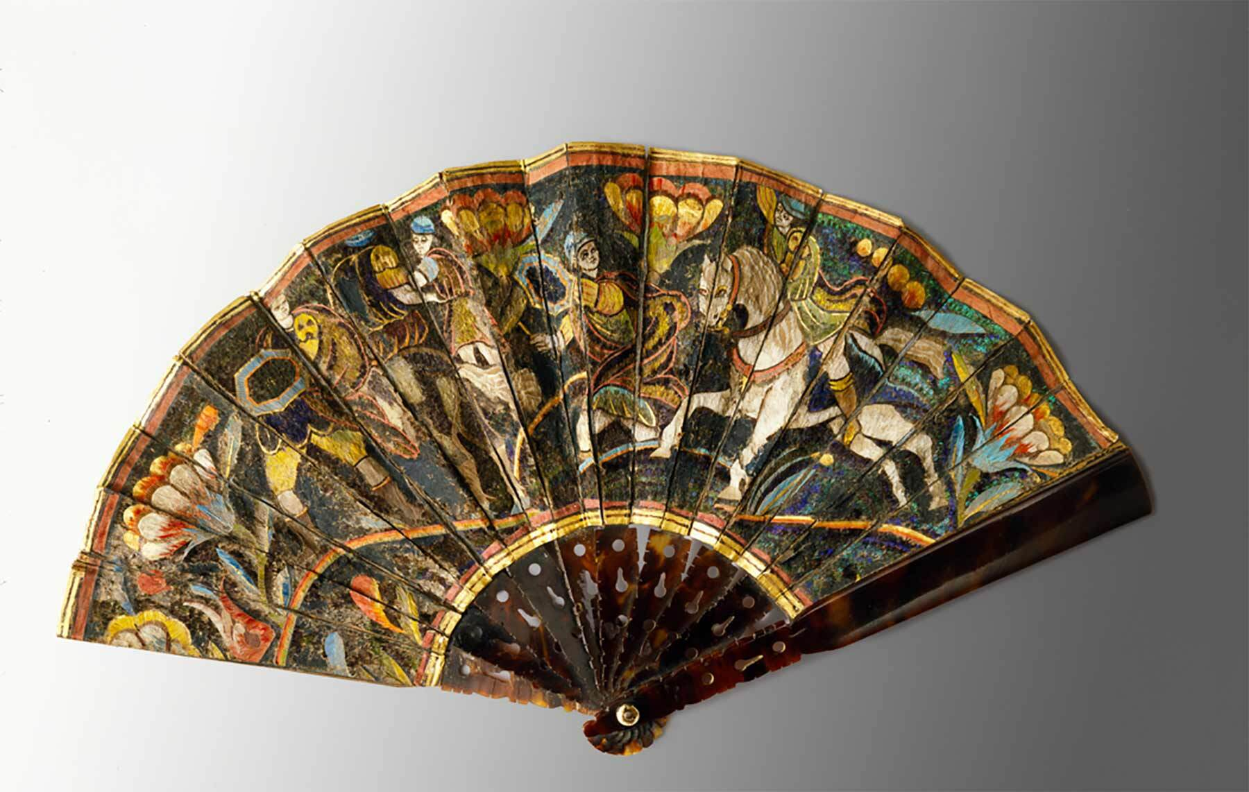 A multi colored open fan with scene on it, 16th century mexican fan.
