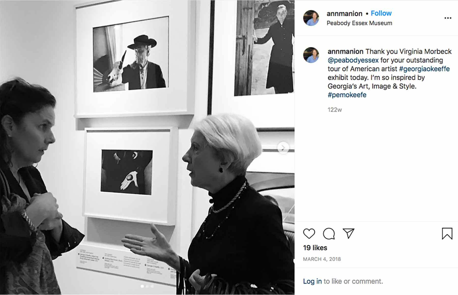 An instagram post of two women talking in a gallery space with Georgia O'Keeffe photographs on the walls